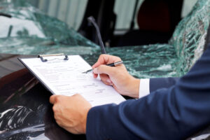 Should I talk to an insurance adjuster if I am injured in a car accident